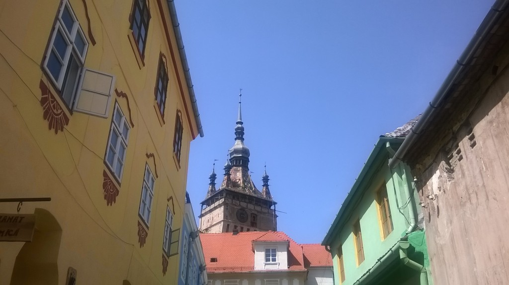 A street in central Sighișoara with the Clock Tower in the background.